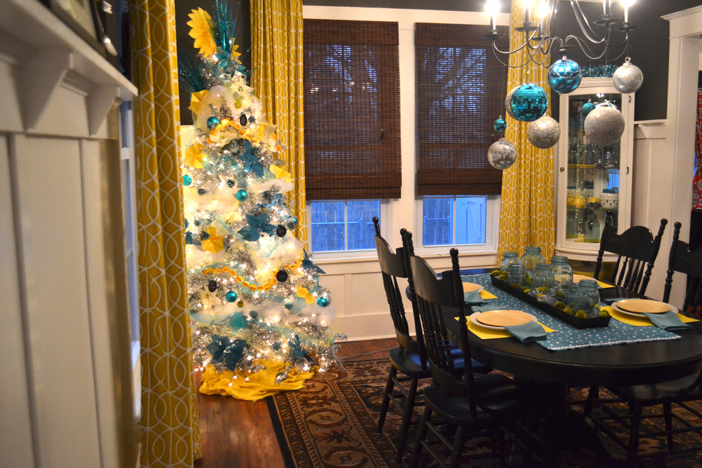 A Silver Christmas Tree With Yellow And Turquoise Diy