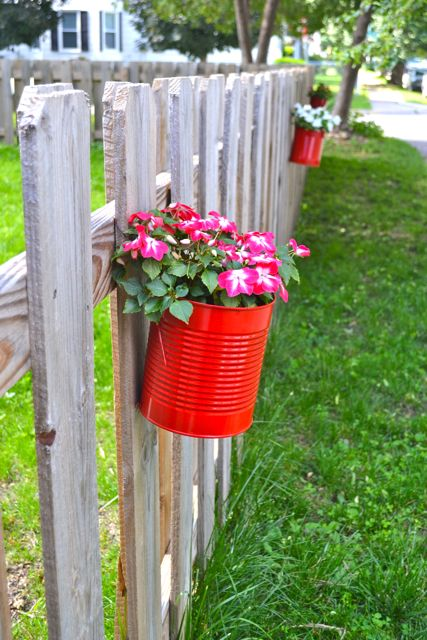 Making fence planters from cans newlywoodwards - Flower pots to hang on fence ...