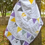 Purple and yellow pennant quilt1