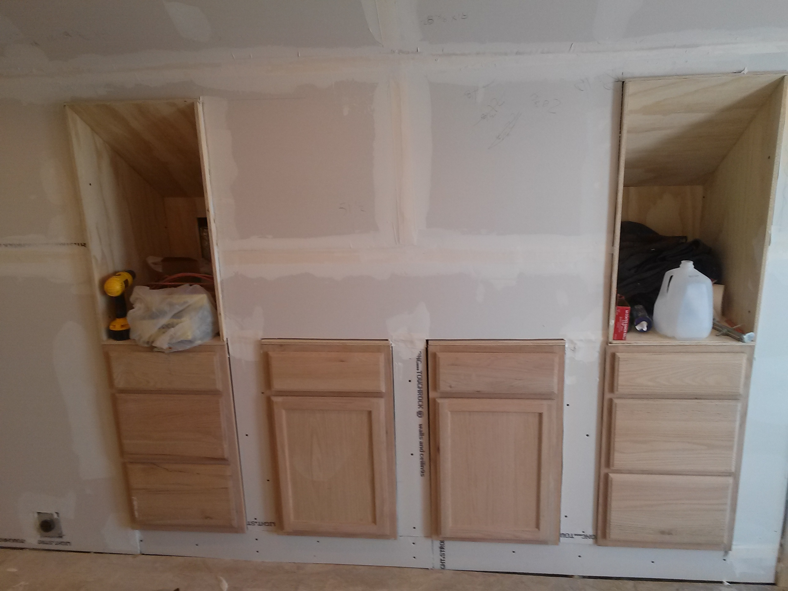 Cute You can see that the kitchen cabinets oven will start right next to the built ins as indicated by the outlet for the stove I can ut decide whether I want