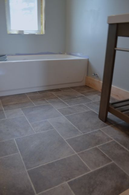 Why i love sheet vinyl and other barn apartment updates for Grey bathroom laminate flooring