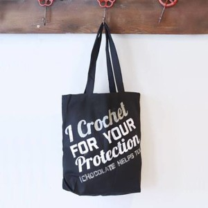 A crochet tote bag with fabric ink
