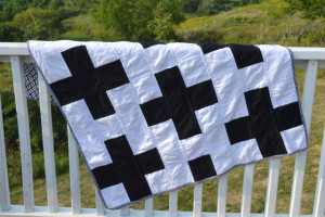 A black and white cross quilt