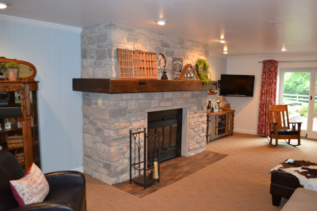 Stone fireplace with barn wood mantel - Weigh In: Ideas For Our Farmhouse Fireplace - NewlyWoodwards