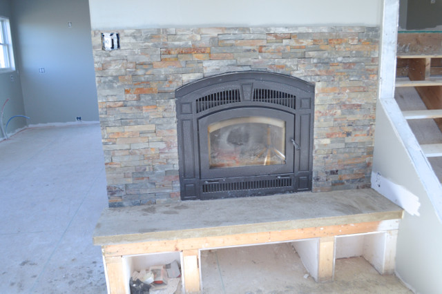 DIY Fireplace with stacked stone and concrete3