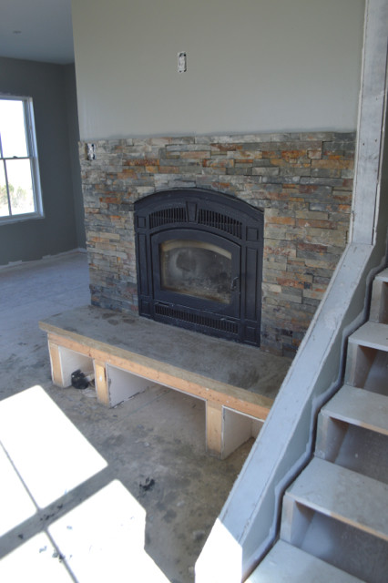 diy fireplace hearth and stacked wall tile