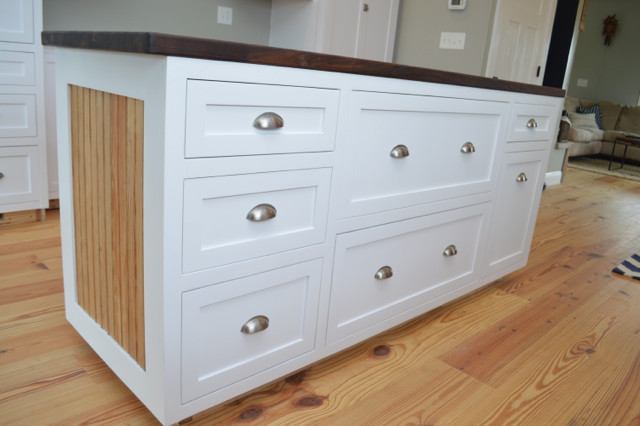 white kitchen island with walnut butcher block top1