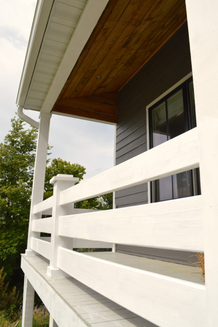 front-porch-white-railings-barnwood-ceiling1