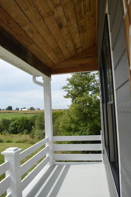 front-porch-white-railings-barnwood-ceiling7