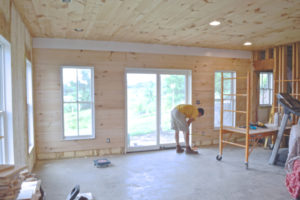 Installing wood flooring as shiplap | Basement progress