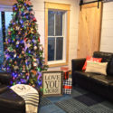 Family Christmas tree with sentimental ornaments and colored lights
