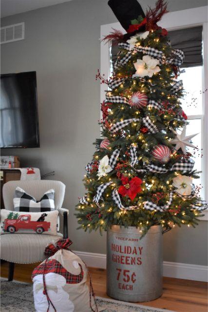 Buffalo check ribbon, ornaments, poinsettias and berries make this tree extra festive.